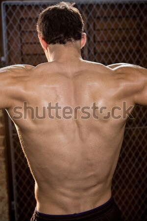 Rear view of a shirtless bodybuilder in gym Stock photo © wavebreak_media