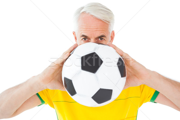 Brazilian football fan in yellow holding ball Stock photo © wavebreak_media