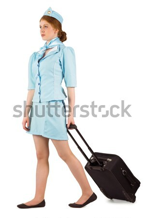 Pretty air hostess pulling suitcase Stock photo © wavebreak_media