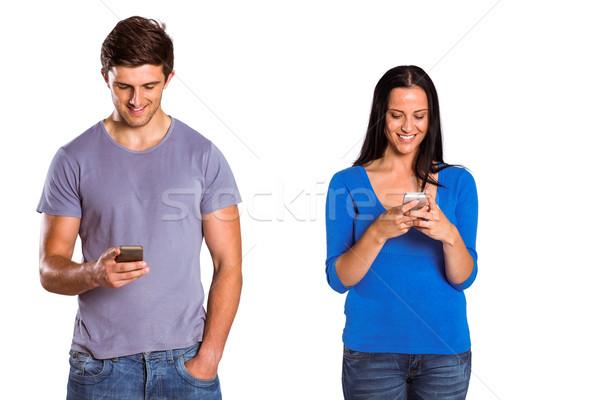 Fiatal pér küldés szöveg fehér női mosolyog Stock fotó © wavebreak_media