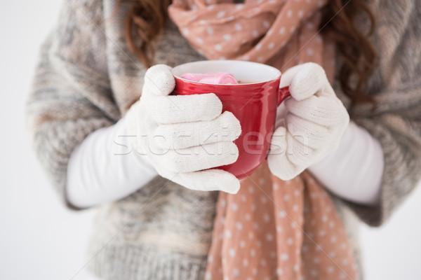 Femme hiver vêtements mug blanche Photo stock © wavebreak_media