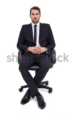 Stern businessman sitting on an office chair  Stock photo © wavebreak_media