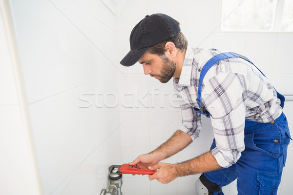 Plumber fixing tap with wrench Stock photo © wavebreak_media