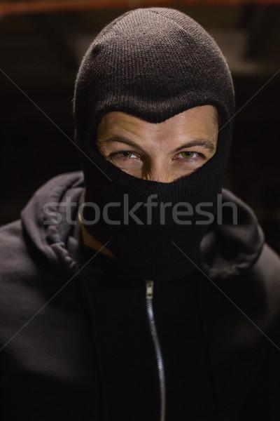 Ritratto scassinatore indossare uomo maschera nero Foto d'archivio © wavebreak_media