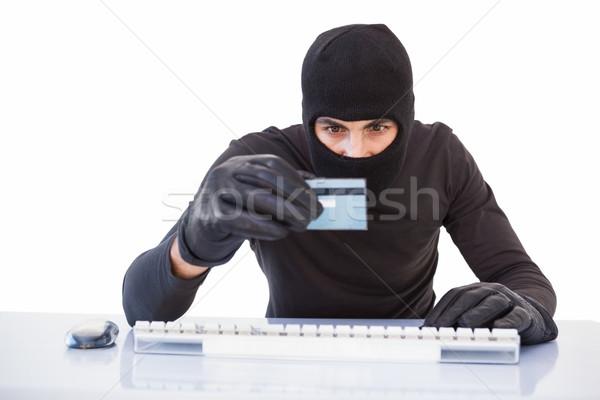 Hırsız online alışveriş dizüstü bilgisayar kredi kartı beyaz bilgisayar Stok fotoğraf © wavebreak_media