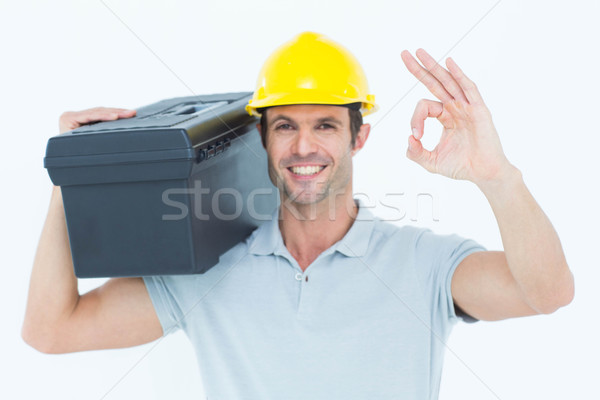 Worker carrying tool box on shoulder while gesturing OK sign Stock photo © wavebreak_media