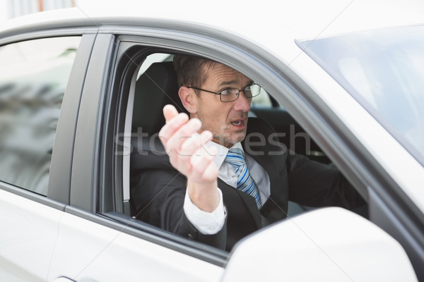 Handsome businessman experiencing road rage Stock photo © wavebreak_media