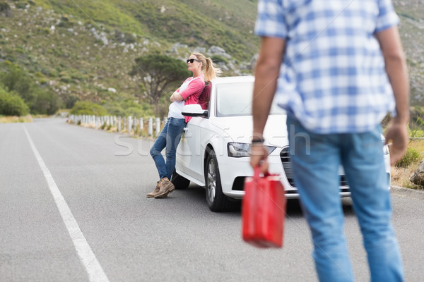 Stock photo: Couple after a car breakdown