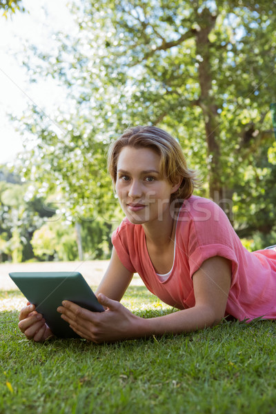 Pretty woman using tablet in park Stock photo © wavebreak_media