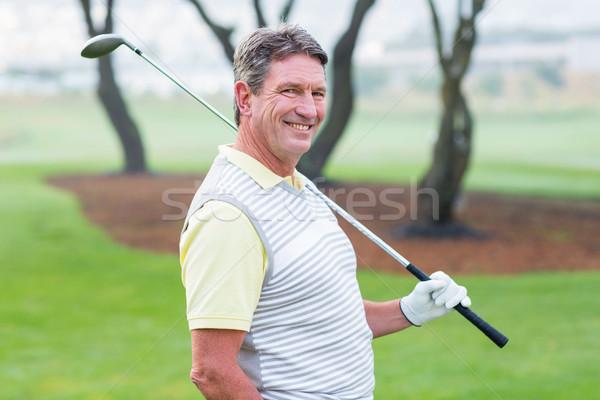 ゴルファー 立って クラブ 笑みを浮かべて カメラ ストックフォト © wavebreak_media
