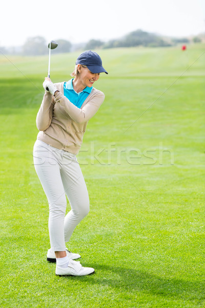 Female golfer taking a shot  Stock photo © wavebreak_media