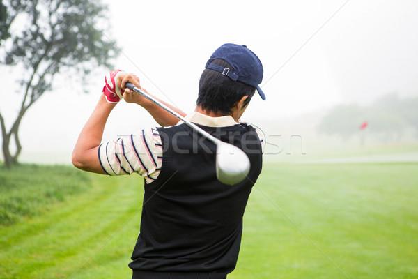 Jogador de golfe campo de golfe nuvens esportes verde Foto stock © wavebreak_media