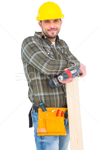 Carpenter holding power drill and wood plank Stock photo © wavebreak_media