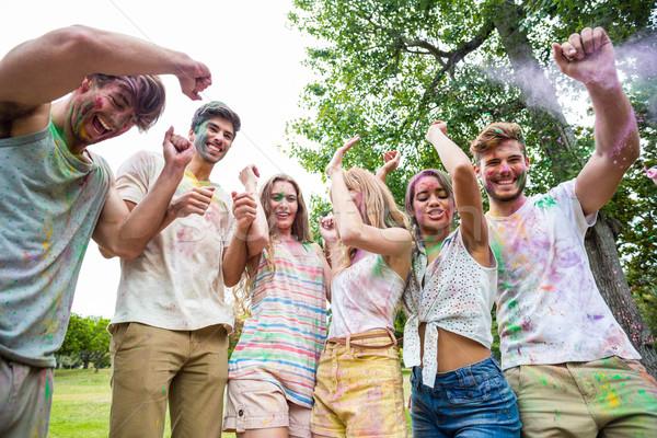 Heureux amis poudre peinture été Photo stock © wavebreak_media