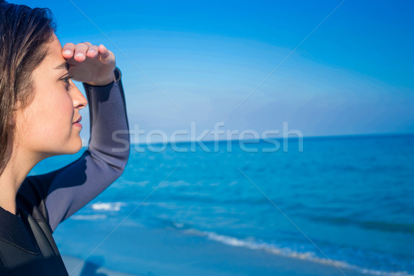 Woman in wetsuit on a sunny day Stock photo © wavebreak_media