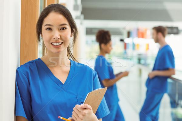 Сток-фото: медик · улыбаясь · камеры · прихожей · университета · медицинской