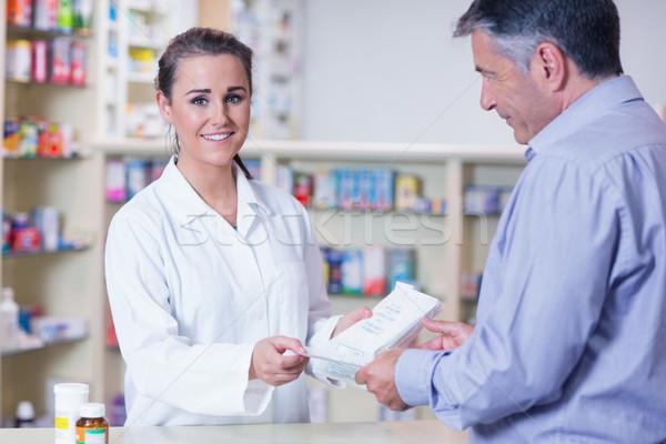 Client ordonnance souriant stagiaire pharmacie heureux Photo stock © wavebreak_media