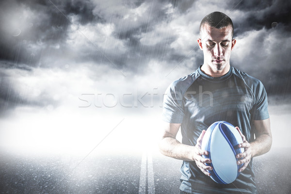 Composite image of thoughtful rugby player holding ball Stock photo © wavebreak_media