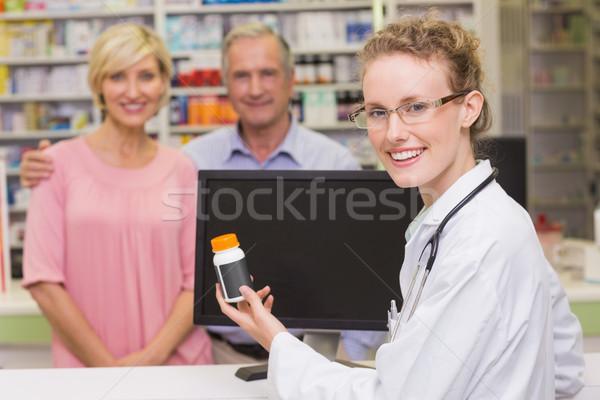 Pharmacien médecine jar client pharmacie Photo stock © wavebreak_media