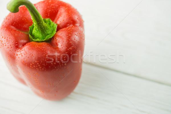 Red pepper on chopping board Stock photo © wavebreak_media