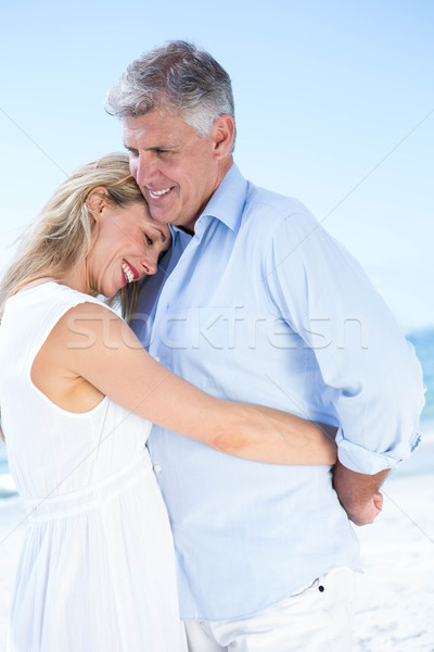 Happy couple standing by the sea and hugging each other Stock photo © wavebreak_media