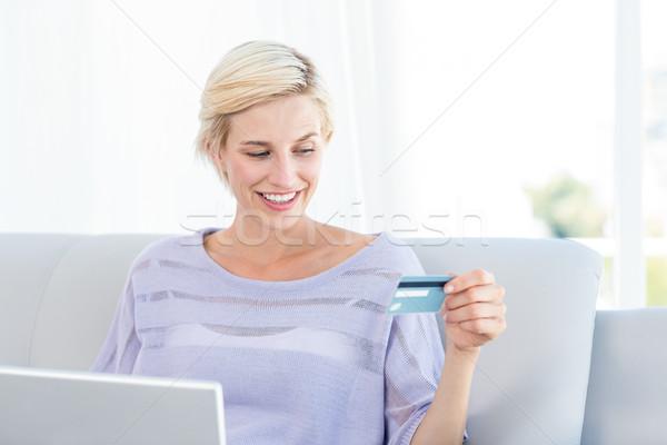 Pretty blonde woman doing online shopping  Stock photo © wavebreak_media