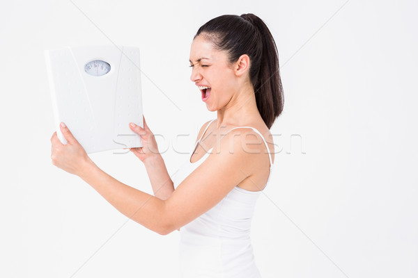 Fit woman holding weighing scales Stock photo © wavebreak_media