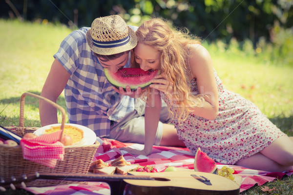 Young couple on a picnic eating watermelon Stock photo © wavebreak_media