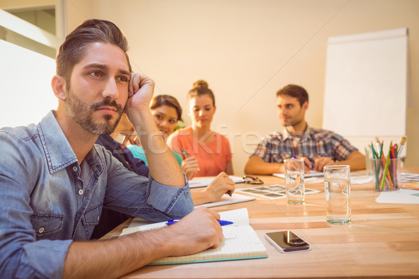 скучно дизайнера заседание служба ноутбук рабочих Сток-фото © wavebreak_media