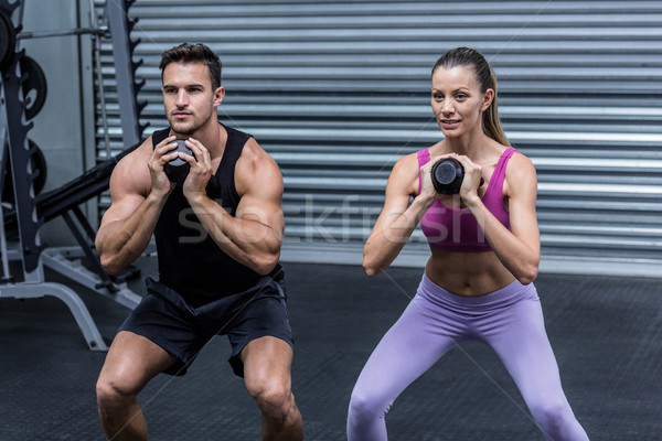 Muscular couple exercising with kettlebells Stock photo © wavebreak_media