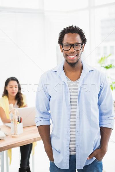 Sorridente homem posando colega escritório computador Foto stock © wavebreak_media