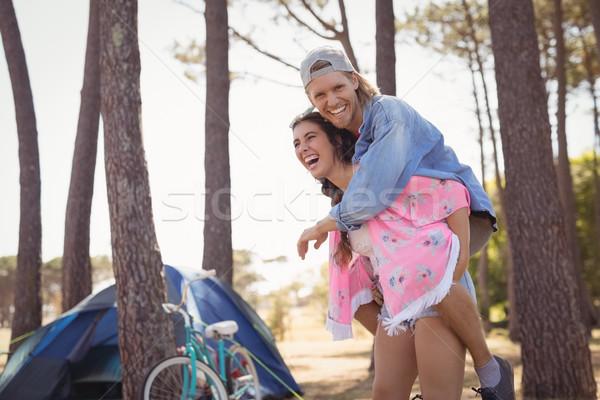 Happy woman piggybacking man Stock photo © wavebreak_media