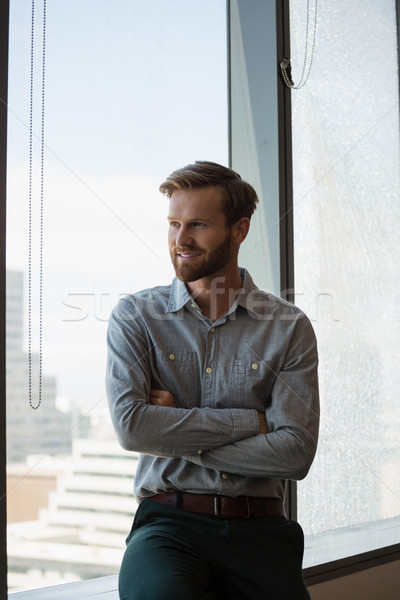 Male executive sitting with arms crossed in office Stock photo © wavebreak_media