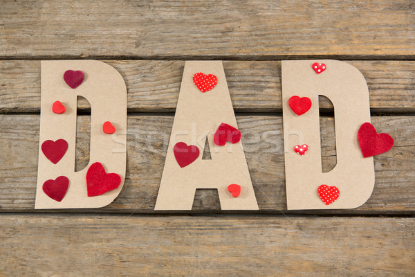 Overhead view of dad text decorated with heart shape Stock photo © wavebreak_media