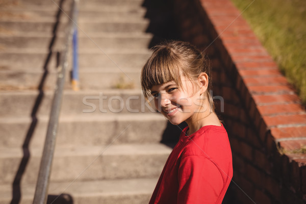 Portrait of happy girl standing near staircase during obstacle course Stock photo © wavebreak_media