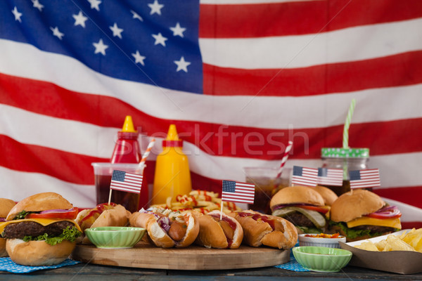 Drinks and snacks arranged on wooden table Stock photo © wavebreak_media