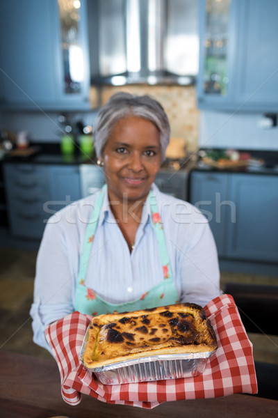 Portrait of senior woman showing baked food Stock photo © wavebreak_media