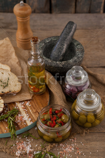 High angle view of olives in container by mortar pestle Stock photo © wavebreak_media