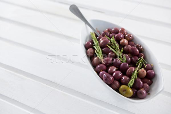 Stock photo: Olives garnished with rosemary