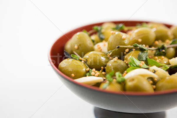 Marinated olives with garlic and herbs in bowl Stock photo © wavebreak_media