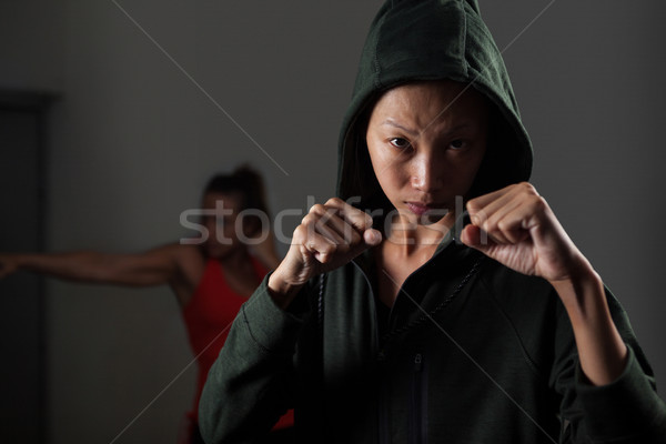 Women practicing boxing in fitness studio Stock photo © wavebreak_media