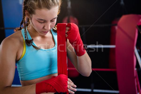 Jovem feminino atleta vermelho bandagem Foto stock © wavebreak_media