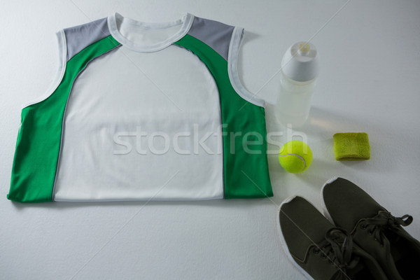 High angle view of vest by bottle and sports shoe Stock photo © wavebreak_media