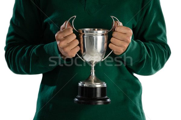 Mid section of female rugby player holding trophy Stock photo © wavebreak_media