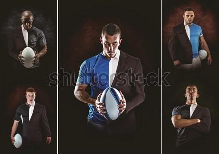 Portrait of rugby player wearing sports uniform holding ball Stock photo © wavebreak_media