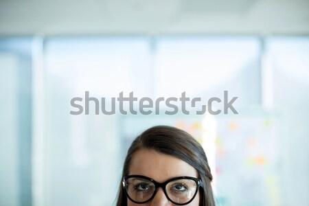 Thoughtful woman by glass window Stock photo © wavebreak_media
