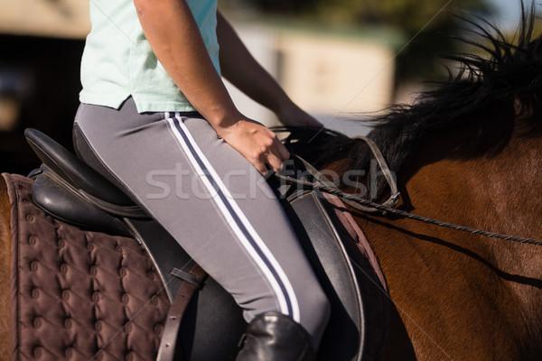 Mid section of female jockey sitting on horse Stock photo © wavebreak_media