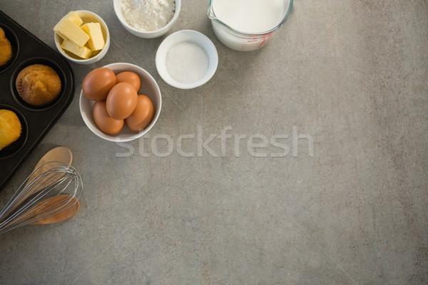 Ingrédients muffin étain table bois cuisine Photo stock © wavebreak_media