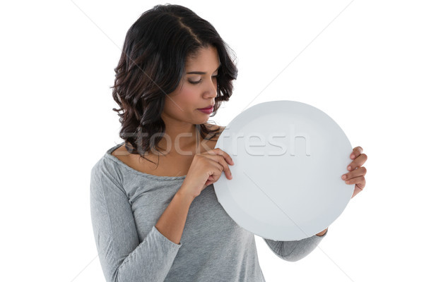 Stock photo: Young woman holding circle shaped placard