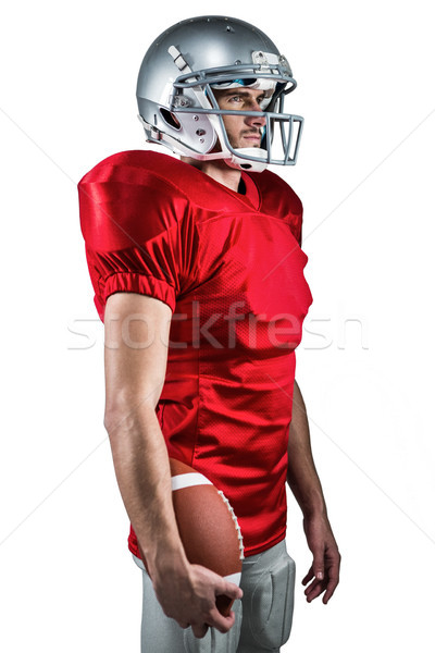 Serious American football player in red jersey looking away whil Stock photo © wavebreak_media
